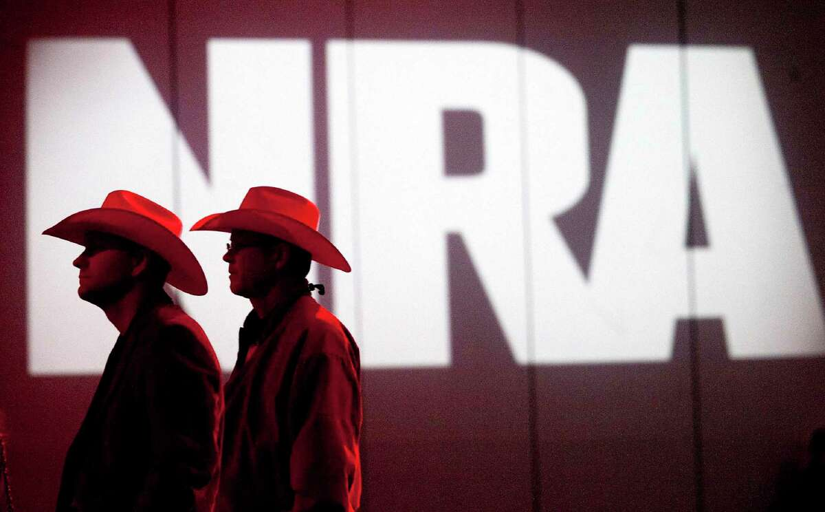 FILE - In this May 4, 2013, file photo, National Rifle Association members listen to speakers during the NRA's Annual Meetings and Exhibits at the George R. Brown Convention Center in Houston. The National Rifle Association announced Friday, Jan. 15, 2021, it has filed for bankruptcy and will seek to incorporate the nation's most politically influential gun-rights group in Texas instead of New York. (Johnny Hanson/Houston Chronicle via AP, File)