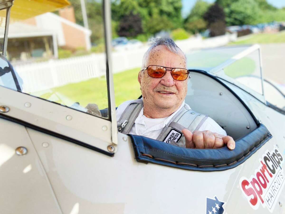 Nestor Gendreau of Higganum is shown in the cockpit of an 81-year-old airplane. Gendreau, 94, flew the aircraft as part of a commemorative event, sponsored locally by Sport Clips and organized by Dream Flights International.