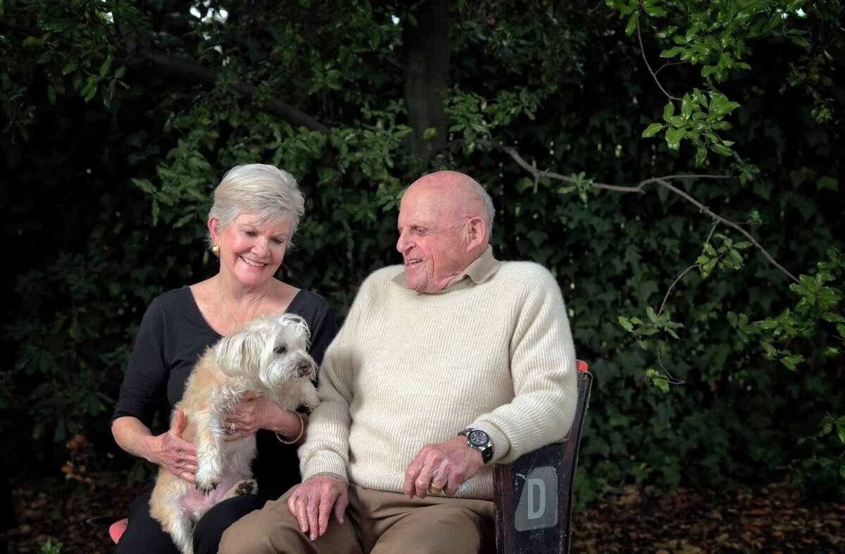 Bob and Connie Lurie with their dog Scooter at their home in Atherton, Calif., on Sunday, February 14, 2021. In 1981, Bob Lurie hired Frank Robinson, the first Black manager in the National League.