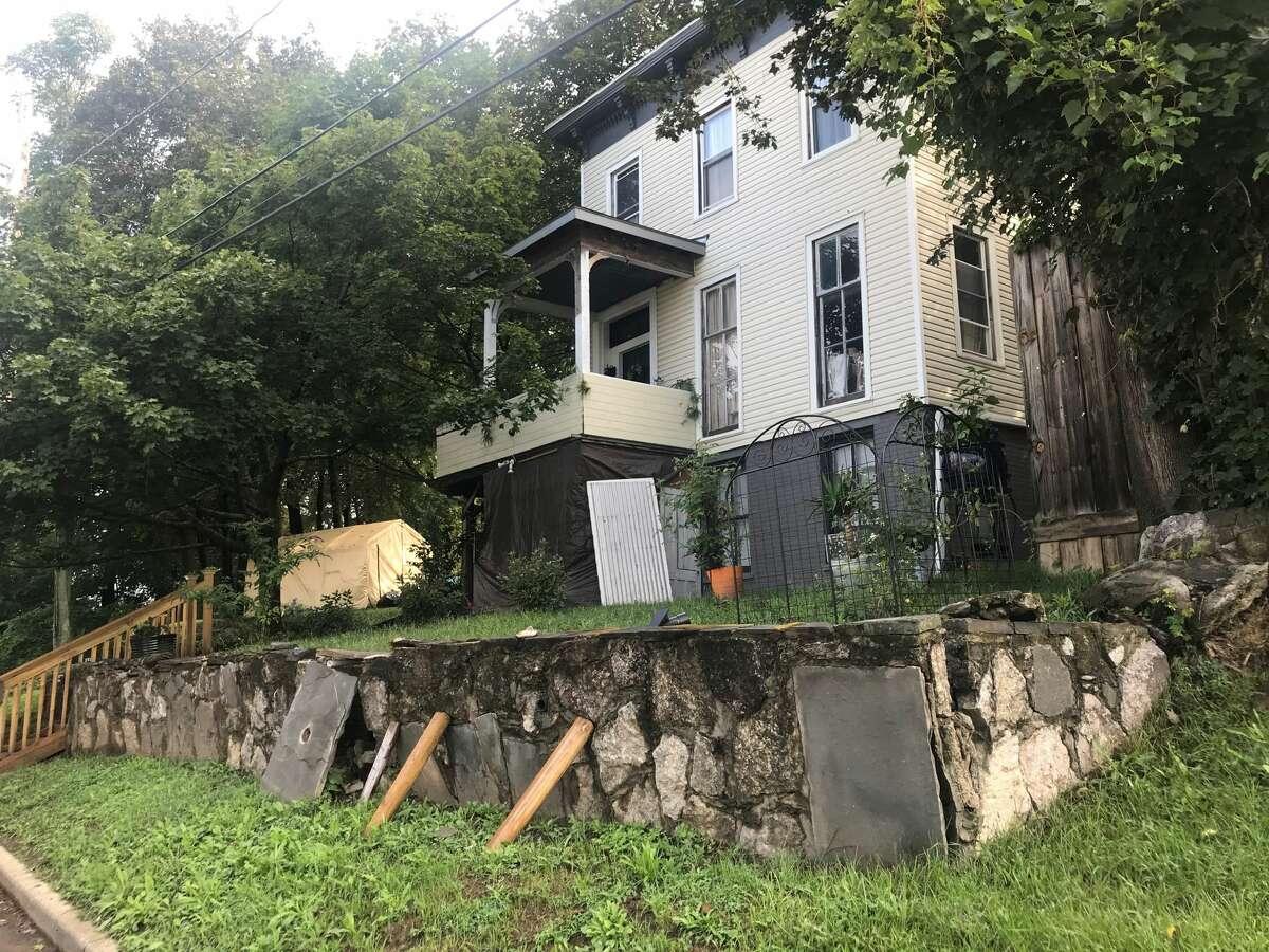 Adam White's house in Catskill, a stone's throw away where neighbors said he collapsed.