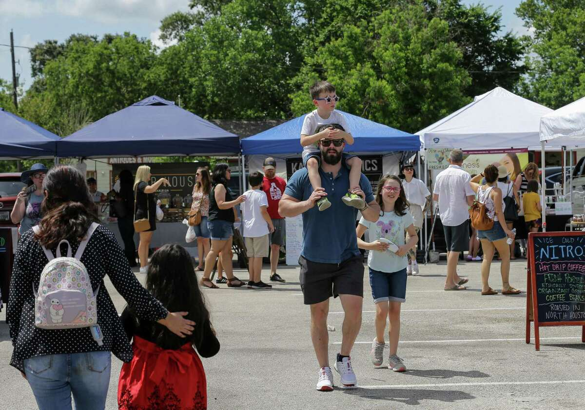 People visit the Tomball Farmers Market -which is located at 205 West Main Street - on Saturday, June 12, 2021, in Tomball