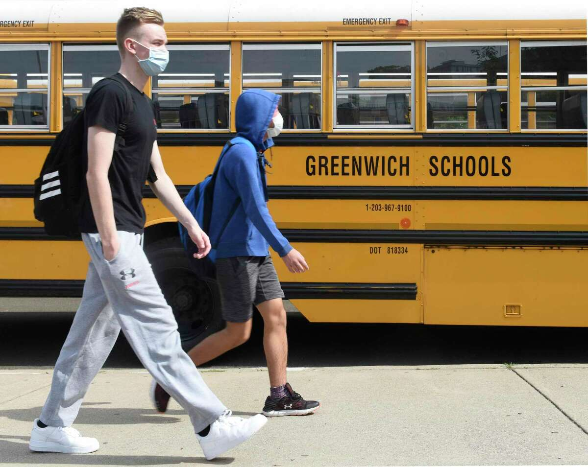 Students are dismissed after the first day of classes at Greenwich High School in Greenwich, Conn. Wednesday, Sept. 9, 2020.
