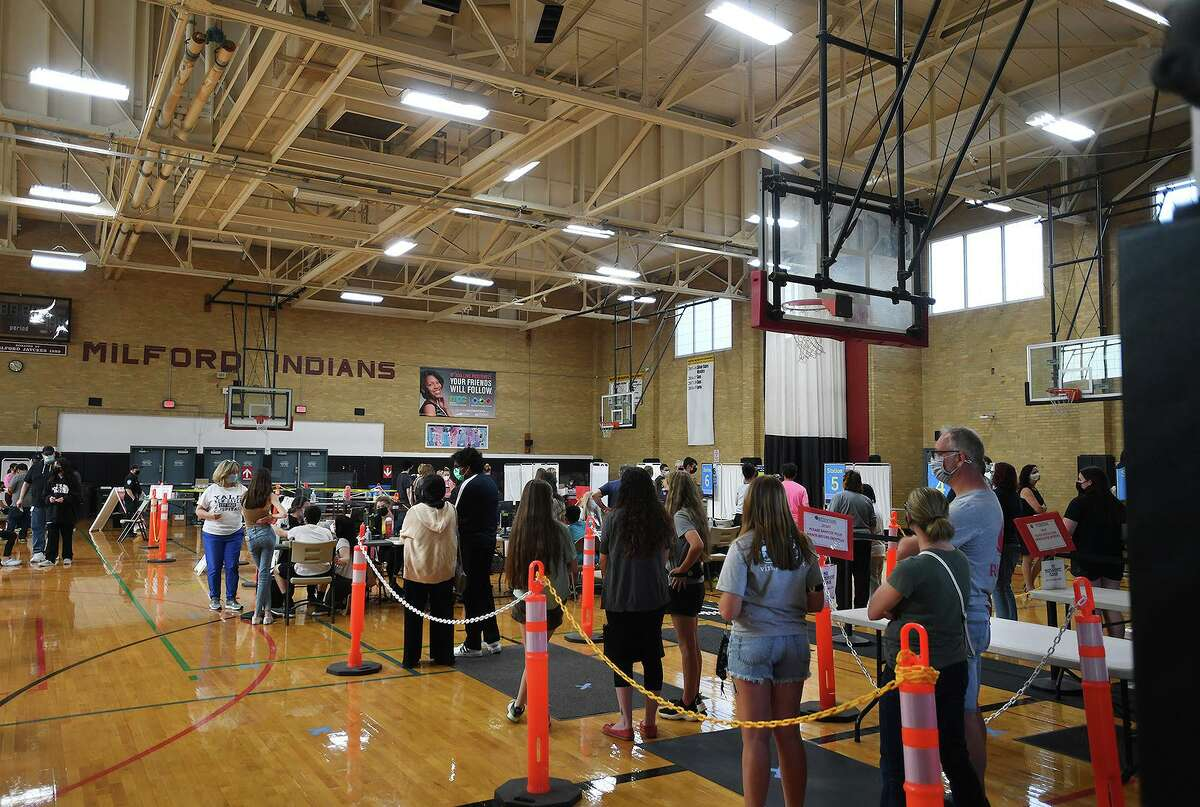 With parents accompanying their kids to provide consent, Milford students line up to receive the Pfizer Covid-19 vaccine at a Yale New Haven Health vaccination clinic at the Parsons Complex gymnasium in Milford, Conn. on Monday, May 17, 2021.,