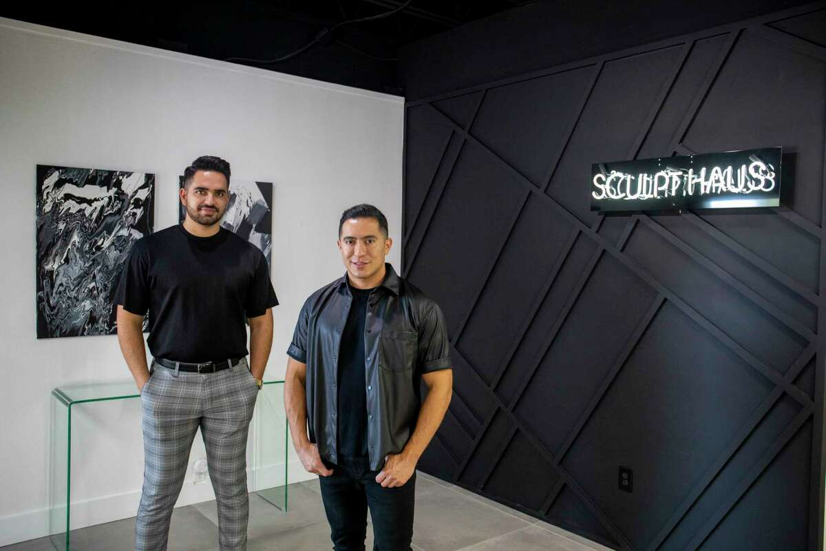 Sip Haus co-owners Emilio Castellon, left, and Lee Sanchez pose for a portrait Tuesday, Aug. 24, 2021 at Sculpt Haus. Jacy Lewis/Reporter-Telegram