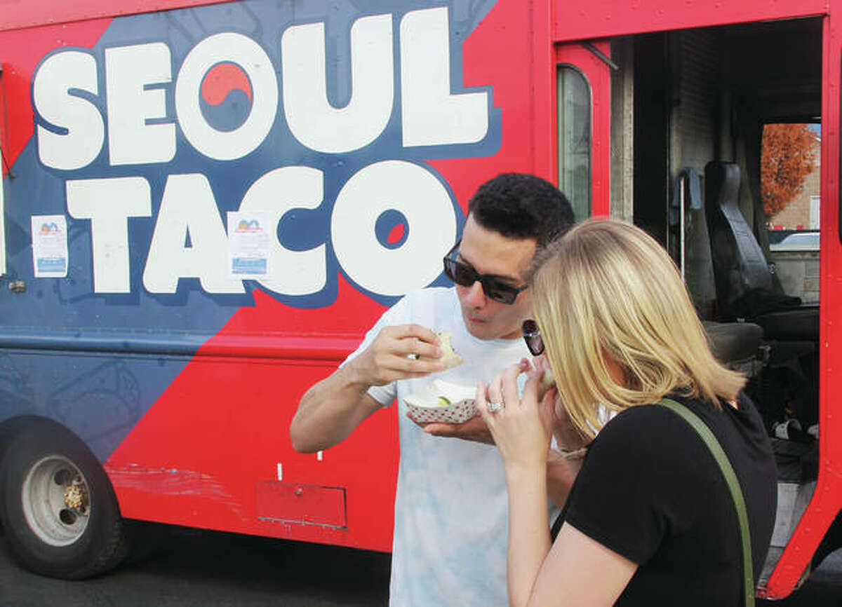 Kenny and Erica Tourville, of Troy, celebrate their eighth wedding anniversary in 2019 with Asian-inspired tacos from Seoul Taco, which is returning to this year's Alton Food Truck Festival, presented by Sauce Magazine 4-8 p.m. Saturday, Aug. 28, at Liberty Bank Amphitheater in Alton. Gates will open at 3:30 p.m. The festival was on hiatus last year due to the pandemic.