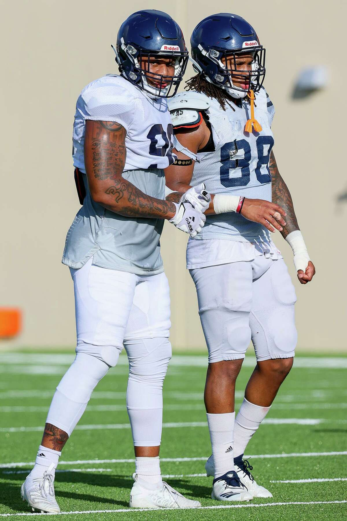 UTSA linebackers Charles Wiley, left, and Jamal Ligon during a morning football practice at the practice fields of the RACE facility on Thursday, Aug. 12, 2021.