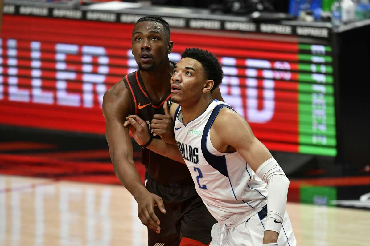 Tyler Bey (front) spent time with the Mavericks during the 2020-21 NBA season.