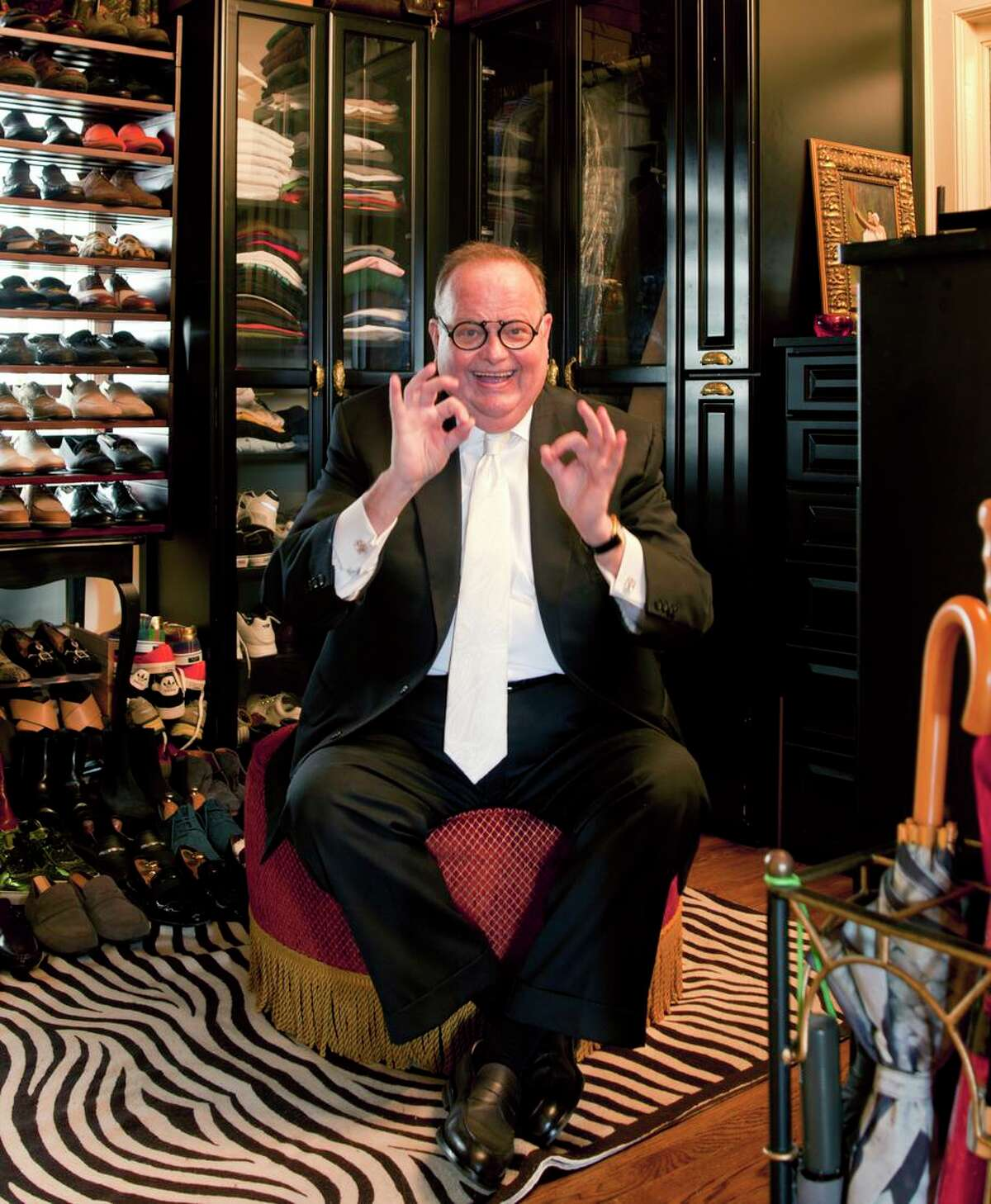 Harry Denton, shown in a former bedroom converted to a walk-in closet at his S.F. flat, was a consummate entertainer.
