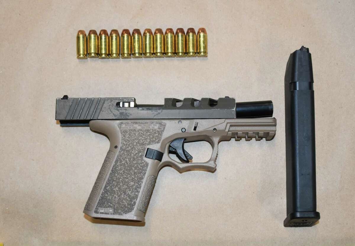 """A loaded polymer non-serialized handgun - known as a """"Ghost gun"""" - with a 30-round magazine."""