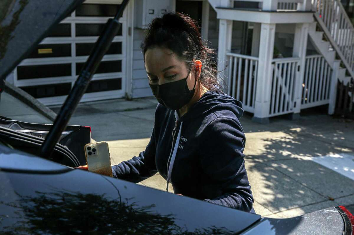 Saori Okawa delivers groceries to an Instacart customer in San Francisco. Okawa is an Instacart shopper and former Uber and Lyft driver who opposes Prop. 22, which classifies rideshare drivers as contract workers instead of full or part-time employees.