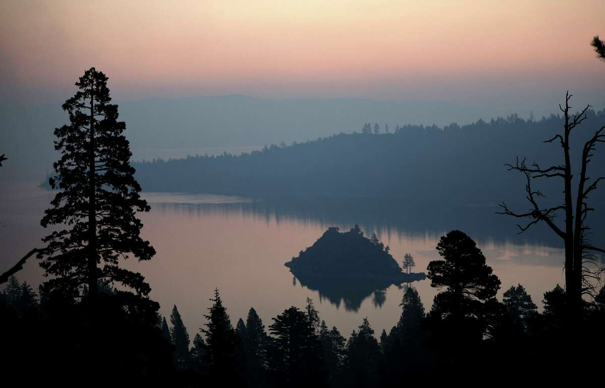 Emerald Bay on Lake Tahoe's west shore glows orange as smoke from several nearby fires fills the Tahoe Basin on Aug. 24.