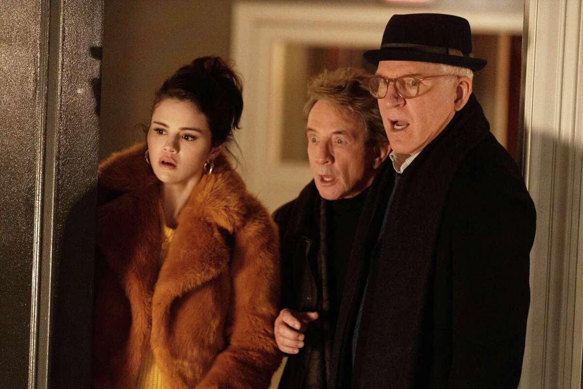 """Selena Gomez as Mabel, Martin Short as Oliver and Steve Martin as Charles respond to one of the many chilling and comedic surprises in Hulu's new murder mystery comedy """"Only Murders in the Building."""""""