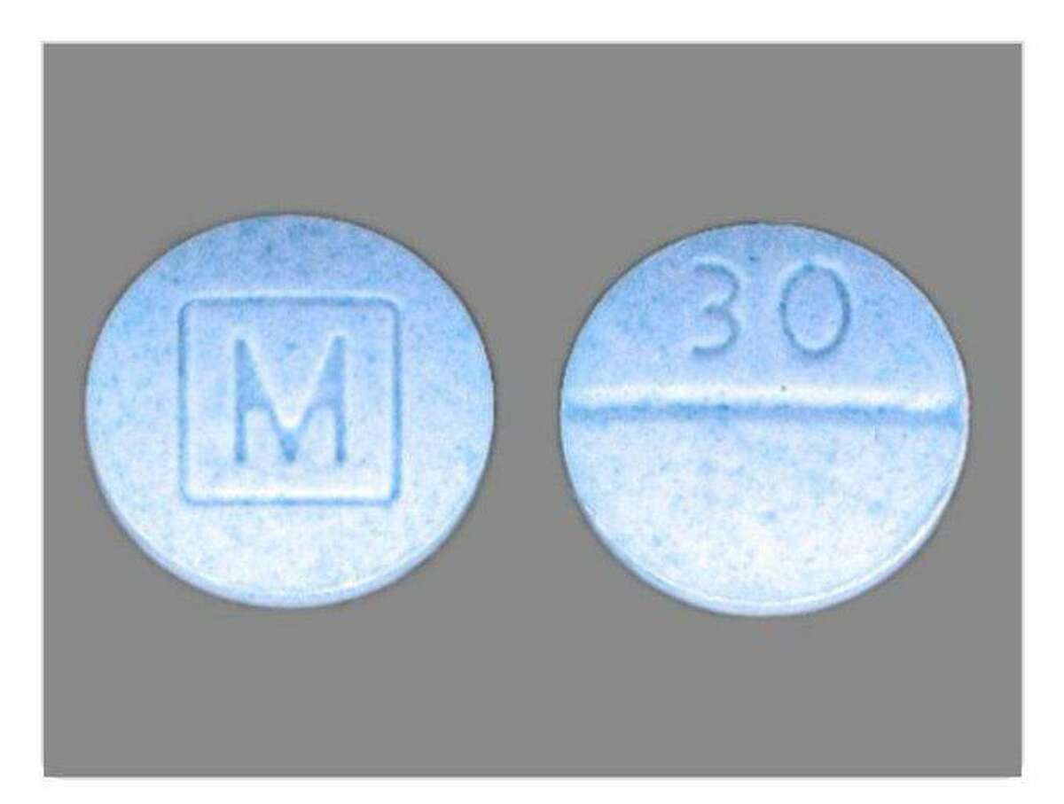 """A 14-year-old Concord High School student died Saturday and police investigators say the teenager may have died from an accidental overdose after taking a pill, authorities said. Concord Police Department said the teen died after ingesting a pill that """"may be similar to"""" a photo shared by police, which shows a circular blue pill with a large """"M"""" inscribed on one side, and """"30"""" in smaller lettering on the other side."""