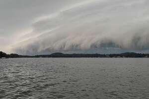 A storm rolls over Hamlin Lake near Ludington on Tuesday, Aug. 24, 2021.