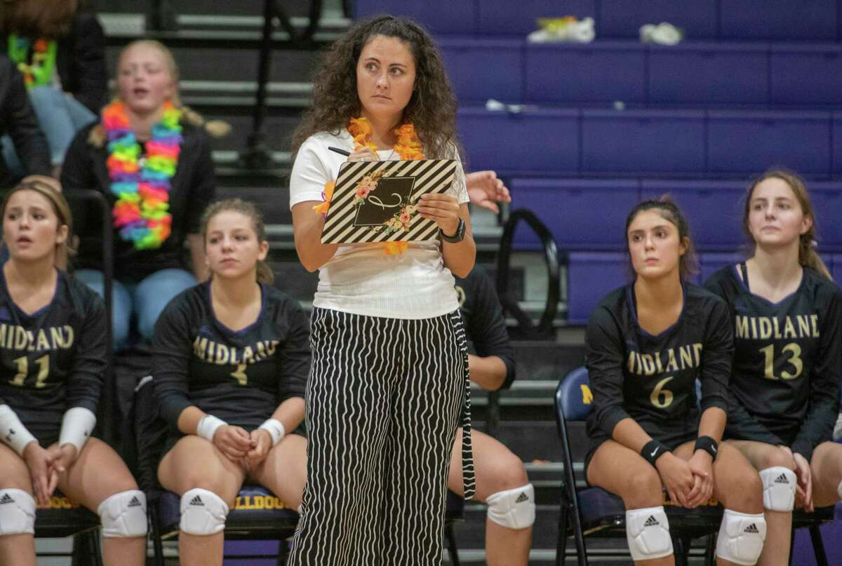 Midland High new head coach Bethany Johnstone keeps track of the game as her players takeon Pecos 08/24/2021 at Midland High gym. Tim Fischer/Reporter-Telegram