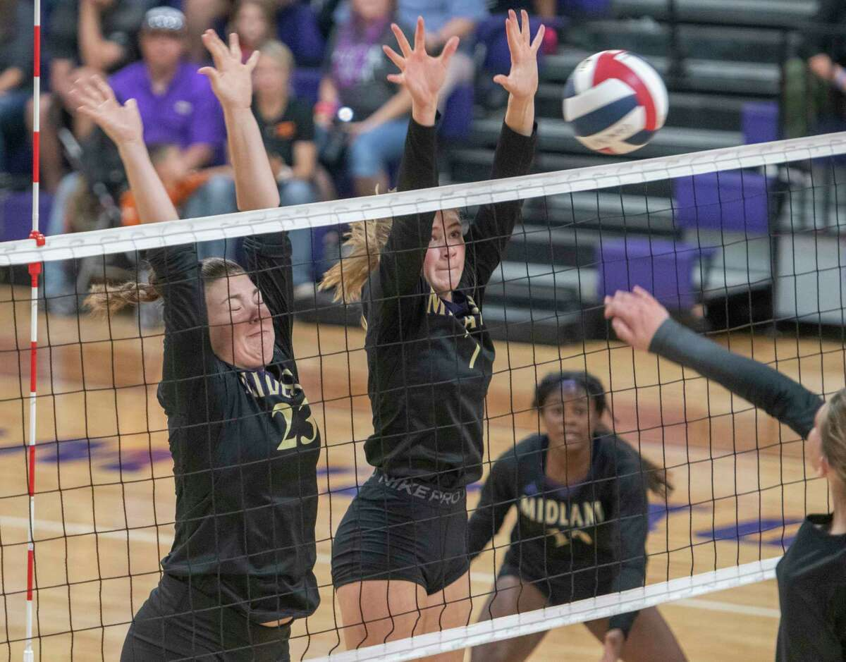 Midland High's Billie Ann Brittain and Brooke Boehler go up for a block as Pecos' Crystal Harrison tries for a kill 08/24/2021 at Midland High gym. Tim Fischer/Reporter-Telegram