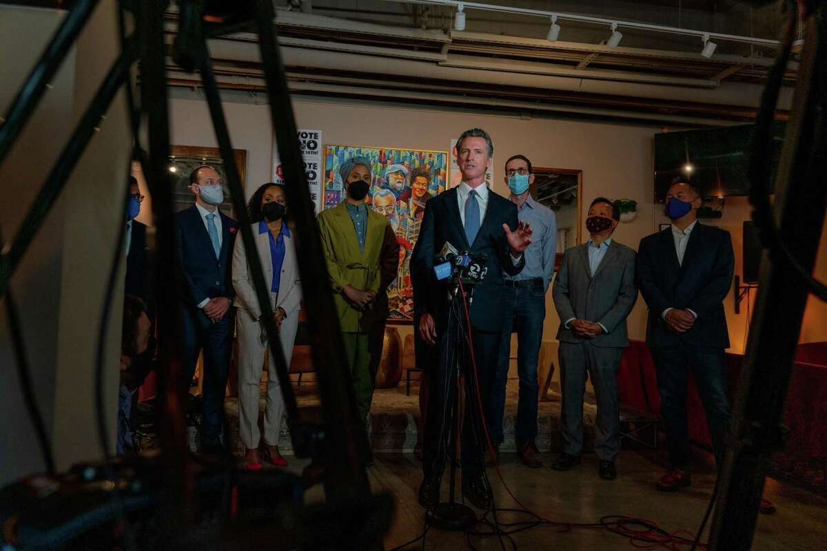 """California Gov. Gavin Newsom other Democratic officials speaks to the media at a press conference kicking off a """"Vote No"""" campaign opposing the recall election at Manny's in San Francisco on Aug. 13."""