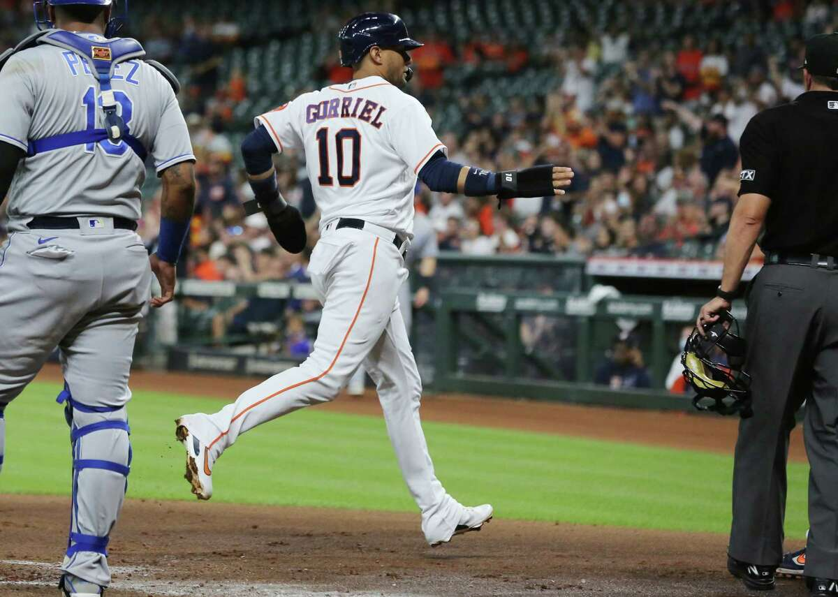 Houston Astros first baseman Yuli Gurriel (10) crosses home plate after scoring off of an error in the first inning against the Kansas City Royals at Minute Maid Park in Houston on Tuesday, Aug. 24, 2021.