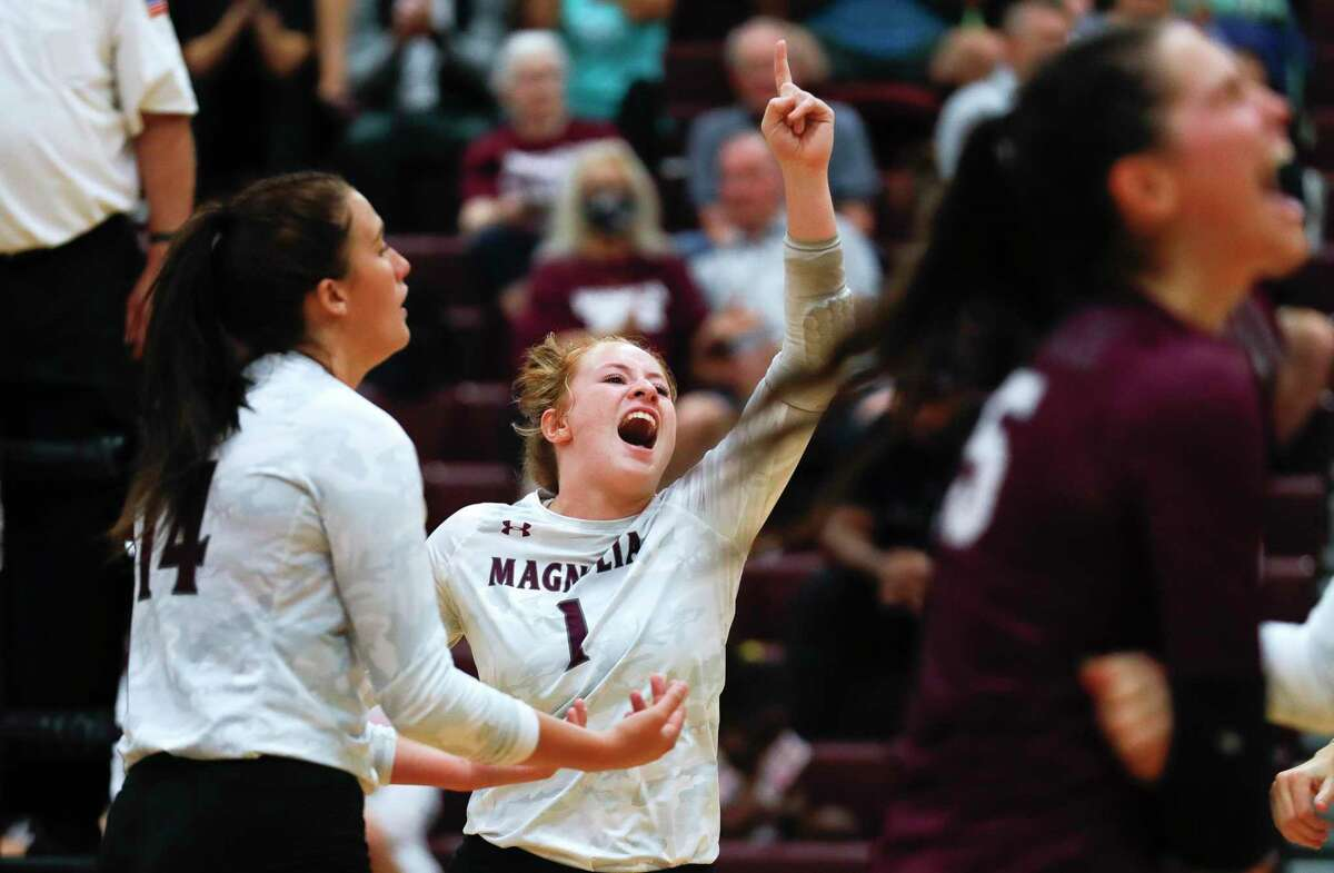 Magnolia outside hitter Kaylee Kelton (1) reacts after a point in the first set during a high school volleyball match at Magnolia High School, Tuesday, Aug. 24, 2021, in Magnolia.