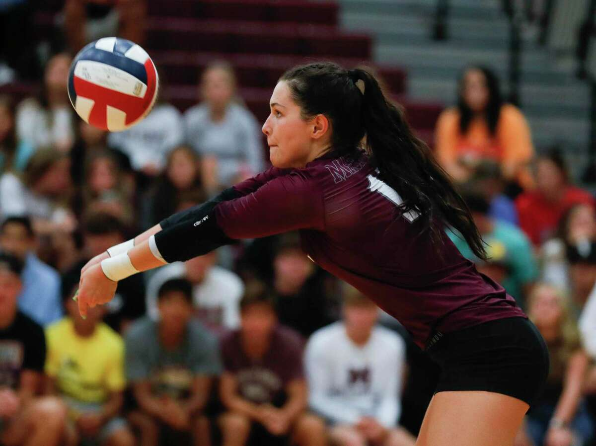 Magnolia libero Kaylyn Fojt (15) returns a hit in the first set during a high school volleyball match at Magnolia High School, Tuesday, Aug. 24, 2021, in Magnolia.