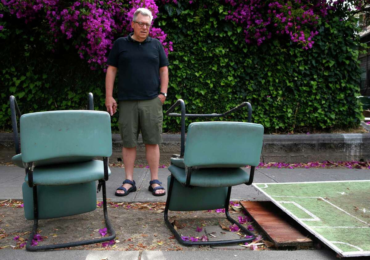 Phil Bokovoy pauses to view abandoned furniture and debris left behind on Benvenue Avenue after Cal students have moved out of apartments for the summer break in Berkeley, Calif. on Thursday, June 27, 2019. Bokovoy is among a group of residents who have filed lawsuits against UC Berkeley over the negative impact that the rising student enrollment has had on the surrounding neighborhoods.