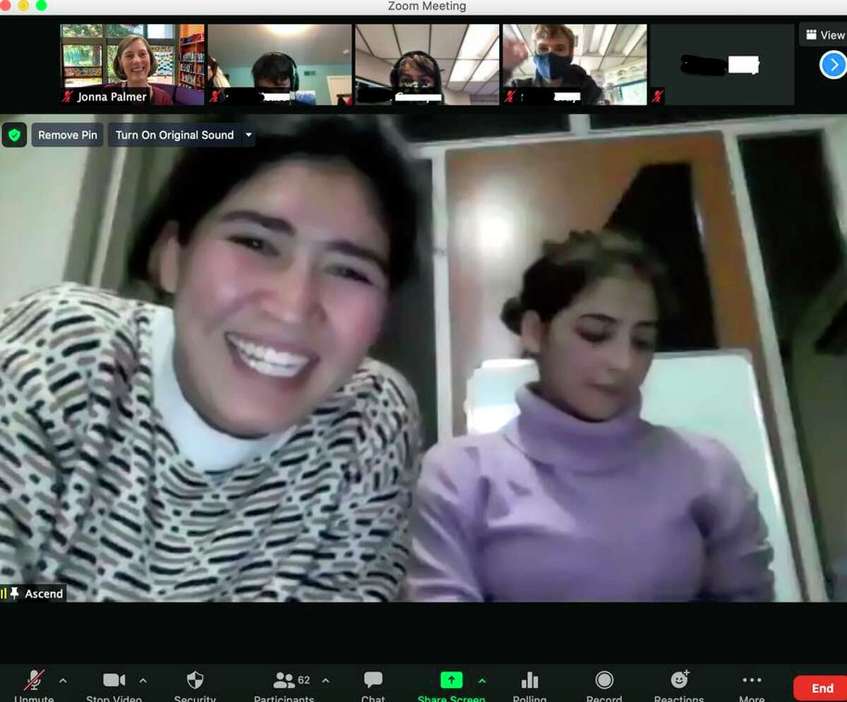 Saeeda Sadat and Shogufa Bayat Haidari, pictured in a Zoom chat with students last year, escaped Afghanistan on Sunday.