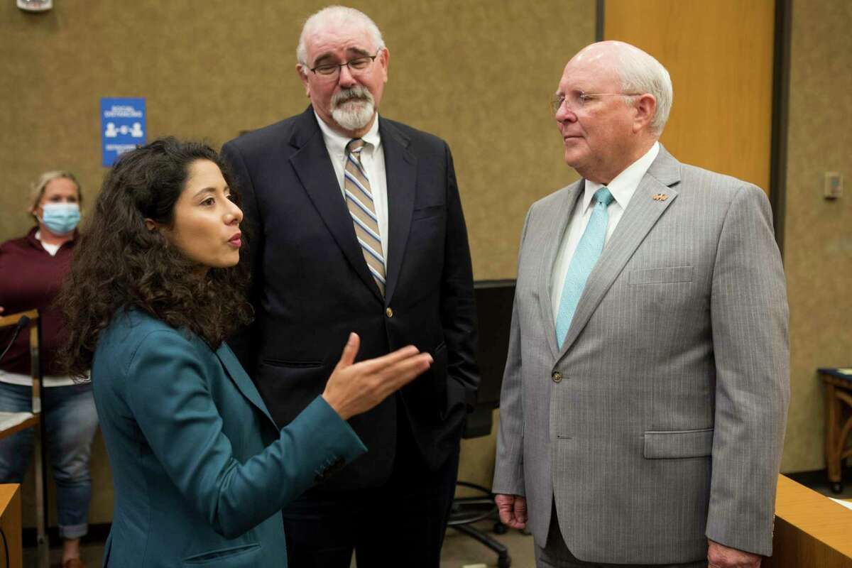 County Judge Lina Hidalgo talks to commissioners Jack Cagle, and Tom Ramsey during a break during Harris County Commissioners Court Tuesday, July 20, 2021 in Houston.