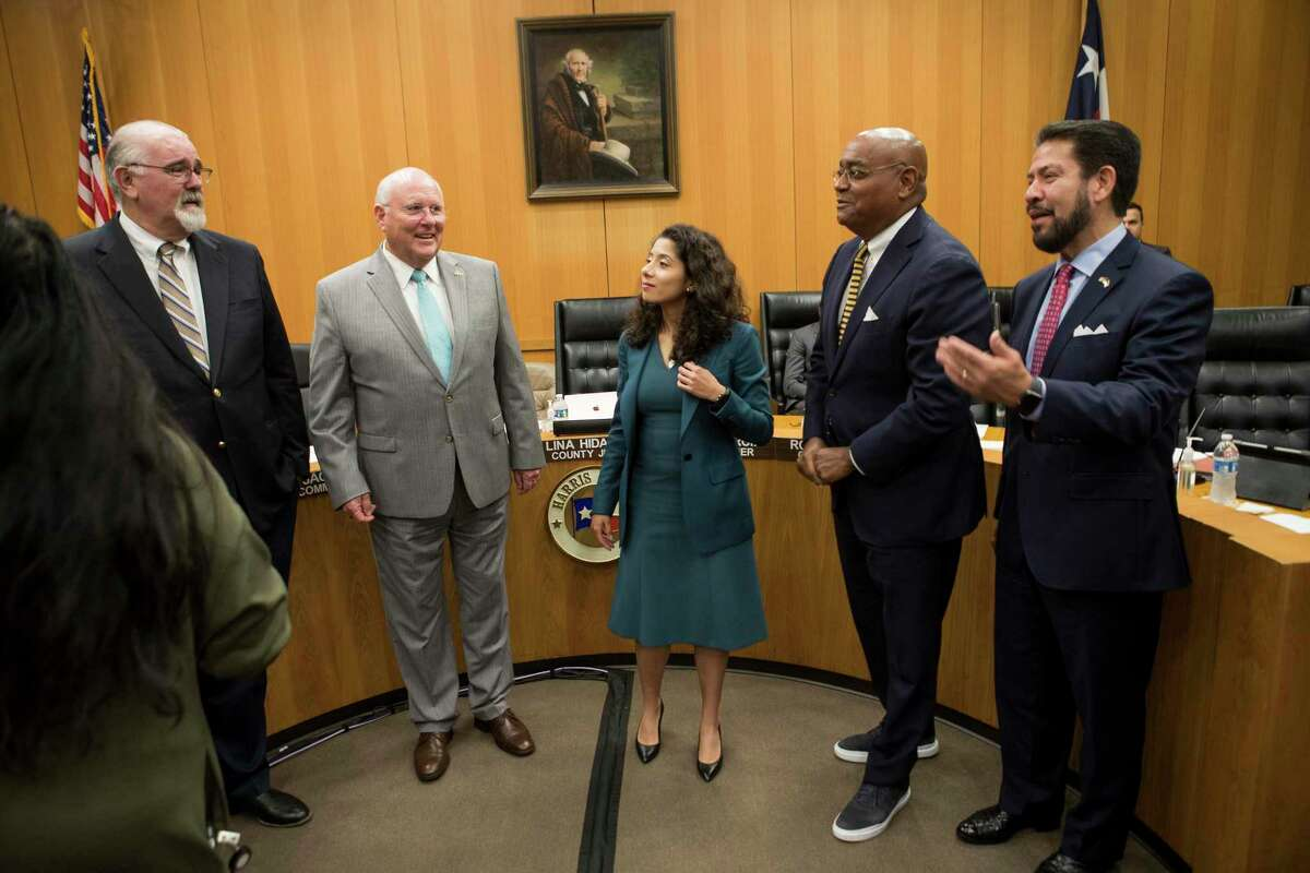 County Commissioners Jack Cagle, left, Tom Ramsey, Judge Lina Hidalgo, Rodney Ellis and Adrian Garcia reach a rare milestone this week - compromise.