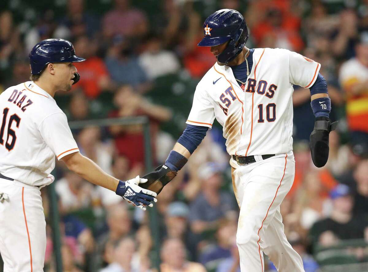 Astros first baseman Yuli Gurriel (10) is congratulated by Aledmys Díaz after scoring on a double by Carlos Correa during the third inning of Tuesday's 4-0 win over the Royals.