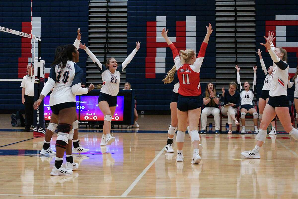 Clear Lake volleyball players celebrate a point scored against Barbers Hill Tuesday at Clear Lake High School.