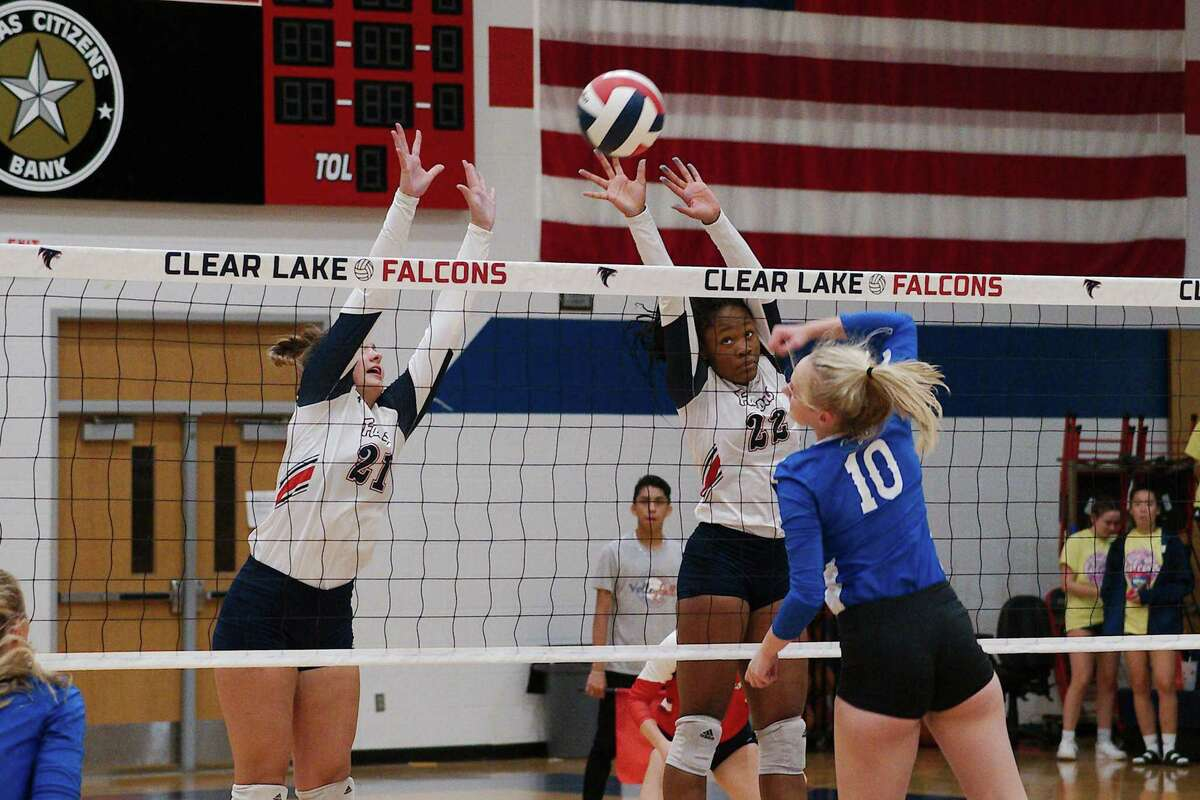 Barbers Hill's Avery Wilks (10) tries to hit a shot past Clear Lake's Kaylee Cannatella (21) and Jenyne Turner (22) Tuesday at Clear Lake High School.