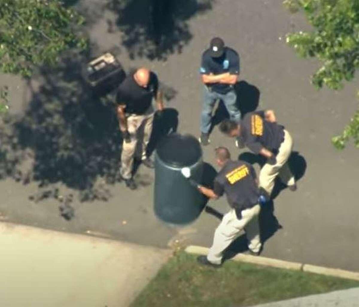 Bergen County investigators dusting a barrel where Flanagan's body was found inside.