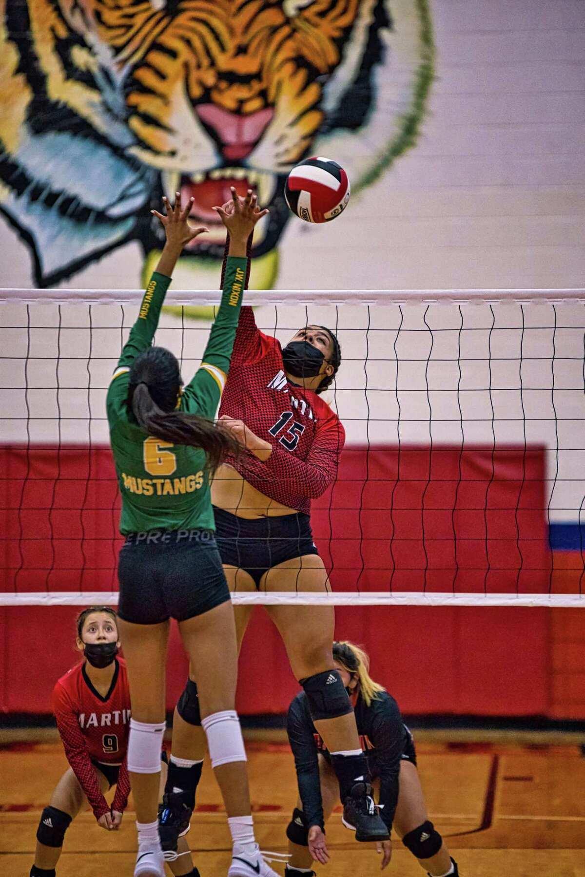 Melanie Duron had a triple-double with 15 kills, 19 digs and 10 blocks Tuesday leading Martin to a 3-0 (25-23, 25-20, 25-18) win at home over rival Nixon.