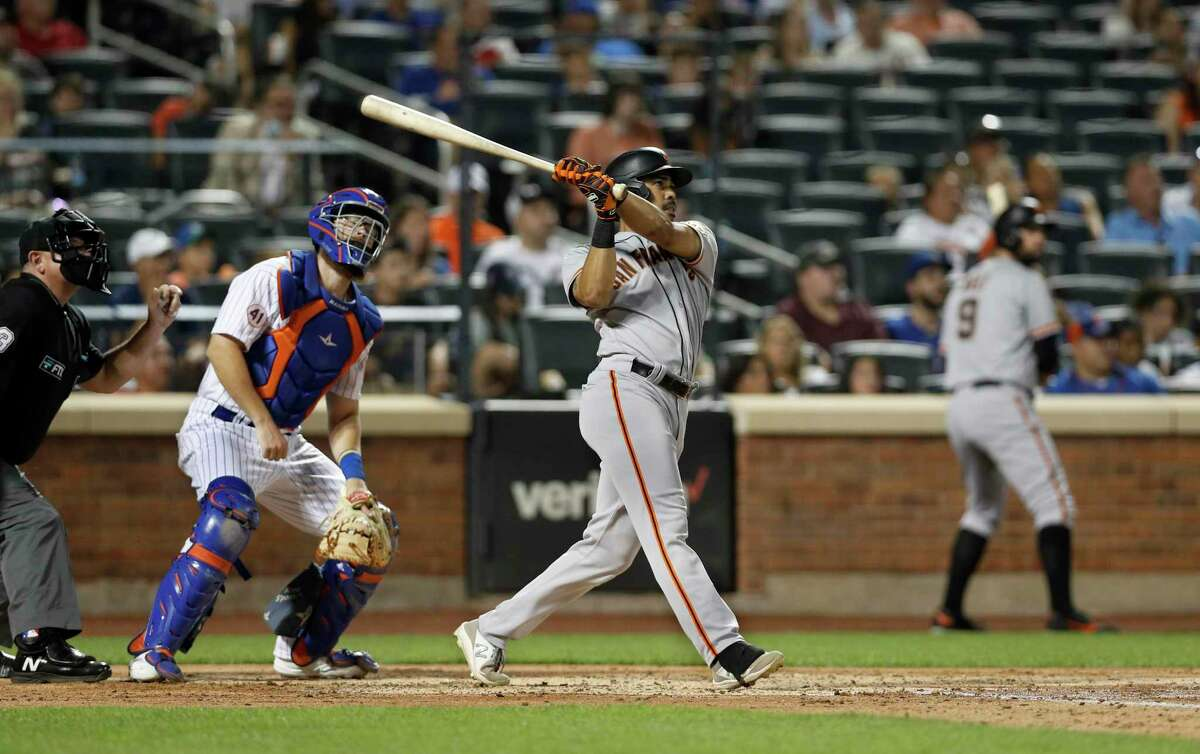 NEW YORK, NEW YORK - AUGUST 24: LaMonte Wade Jr. #31 of the San Francisco Giants follows through on his fourth inning two run home run against the New York Mets at Citi Field on August 24, 2021 in New York City. (Photo by Jim McIsaac/Getty Images)