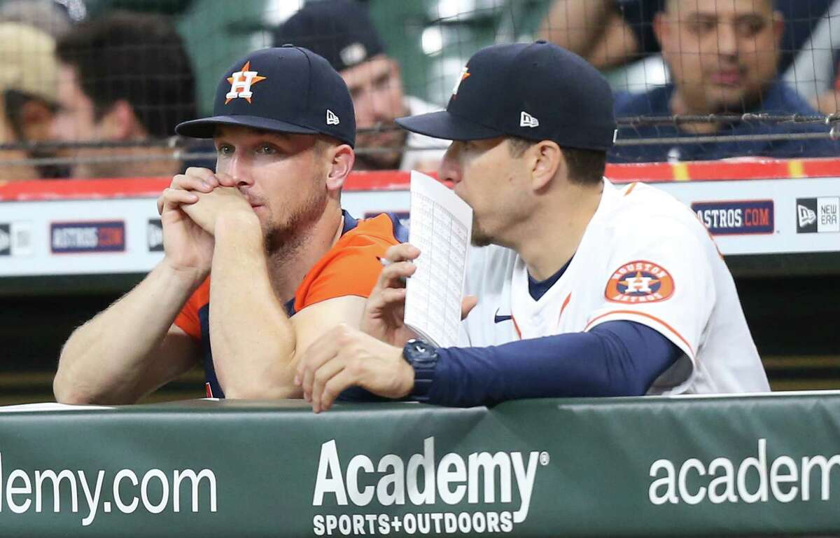Houston Astros third baseman Alex Bregman (2) chats with hitting coach Troy Snitker (46) as they host the Kansas City Royals at Minute Maid Park in Houston on Tuesday, Aug. 24, 2021.