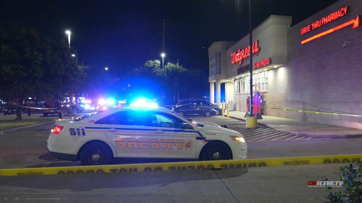 Authorities investigate a shooting outside a Walgreens at 388 Uvalde, Aug. 24, 2021