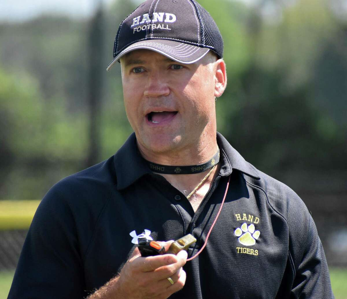 Hand coach Erik Becker talks to his team during a joint practice between Hand and Greenwich at Strong Field, Madison on Tuesday, Aug. 24, 2021.