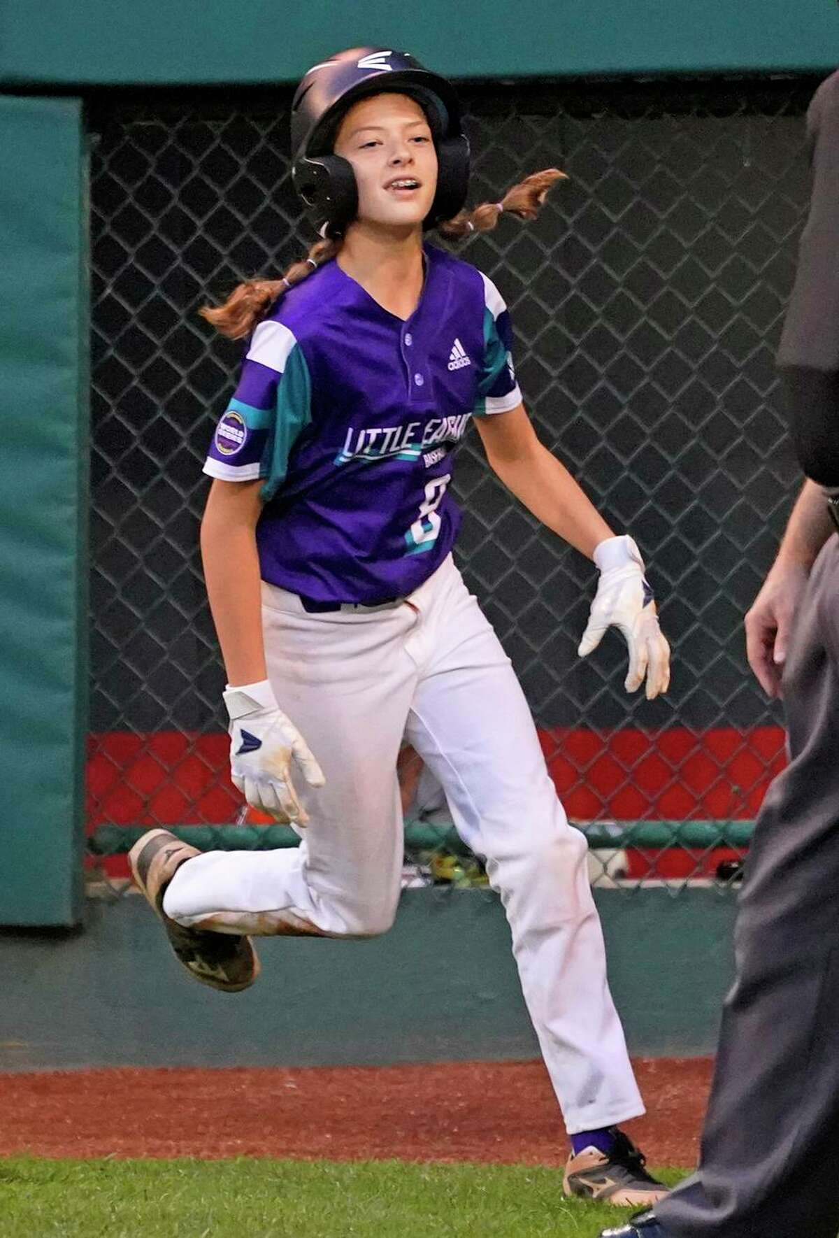 Bruning runs back to the dugout after scoring on a wild pitch by Sammamish, Wash.'s starting pitcher Sanath Chari during the second inning of a baseball game at the Little League World Series in South Williamsport, Pa., Friday, Aug. 20, 2021. (AP Photo/Gene J. Puskar)