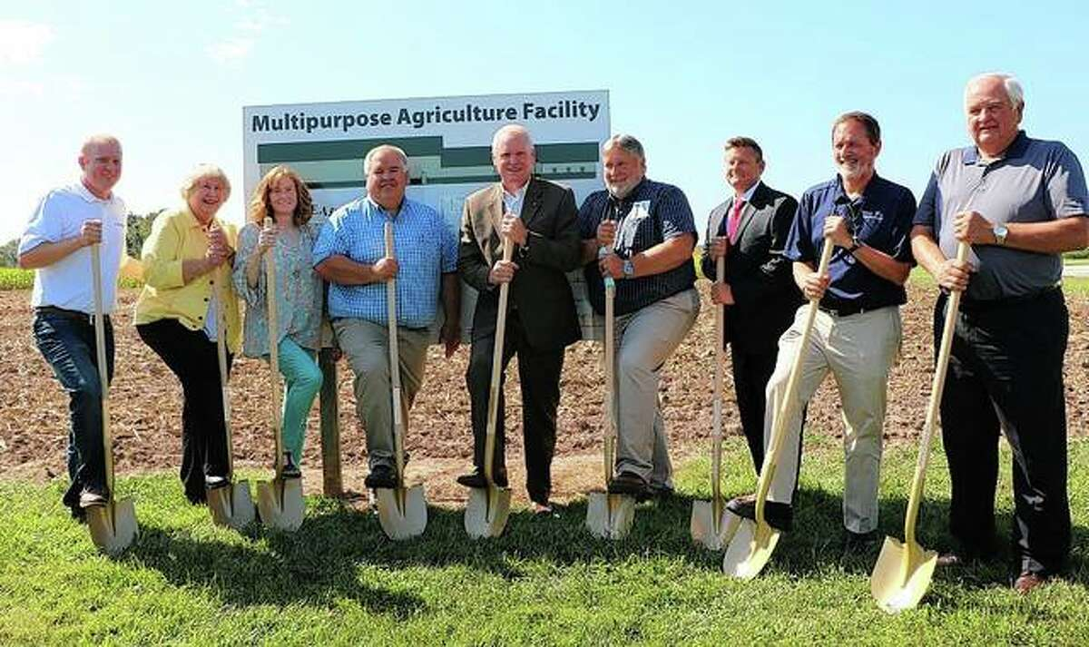 Attending a groundbreaking Tuesday for a multipurpose agriculture facility at John Wood Community College's Agricultural Center in Baylis were Brock Willard (from left) of Compeer Financial; Carole Bradshaw, Lori Bradshaw and Matthew Bradshaw, all of Orr Corp.; Mike Elbe, John Wood Community College president; Mike Tenhouse of JWCC; Nevin Grisby, president of Farmers State Bank of Pittsfield and Gray Trust; German Bollero, associate dean for research at the University of Illinois; and Larry Fischer, JWCC trustee.