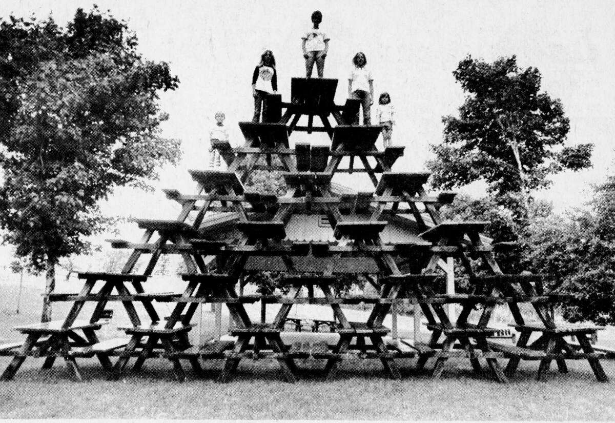 It took 21 picnic tables and some awfully energetic pranksters to put together this pyramid at Orchard Beach State Park. It was unknown who assembled the pyramid overnight. The photo was published in the News Advocate on Aug. 26, 1981. (Manistee County Historical Museum photo)