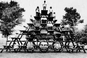 It took 21 picnic tables and some awfully energetic pranksters to put together this pyramid at Orchard Beach State Park. The pyramid was assembled overnight by persons unknown. The photo was published in the News Advocate on Aug. 26, 1981. (Manistee County Historical Museum photo)