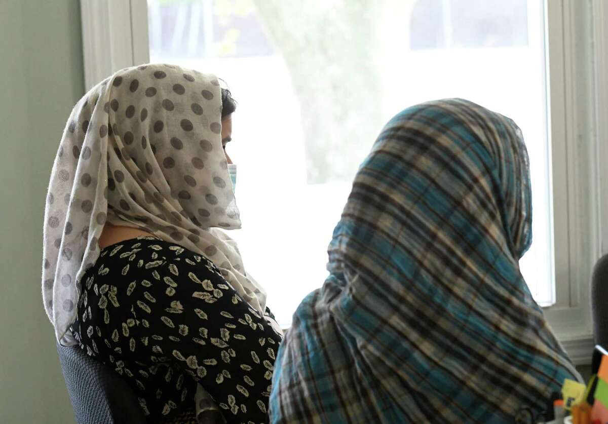 Afghan women, who wished not be identified, describe the horrors faced by family member trying to flee the recently upturned nation on Tuesday, Aug. 24, 2021, during an interview in Albany, N.Y.
