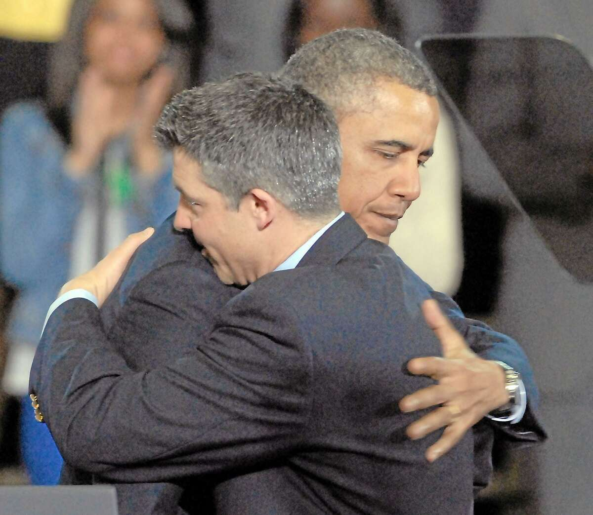 University of Hartford, West Hartford: President Barack Obama hugs Ian Hockley, father of Dylan, before Obama was to speak on gun control. Mara Lavitt/New Haven Register ¬ ¬ 4/8/13