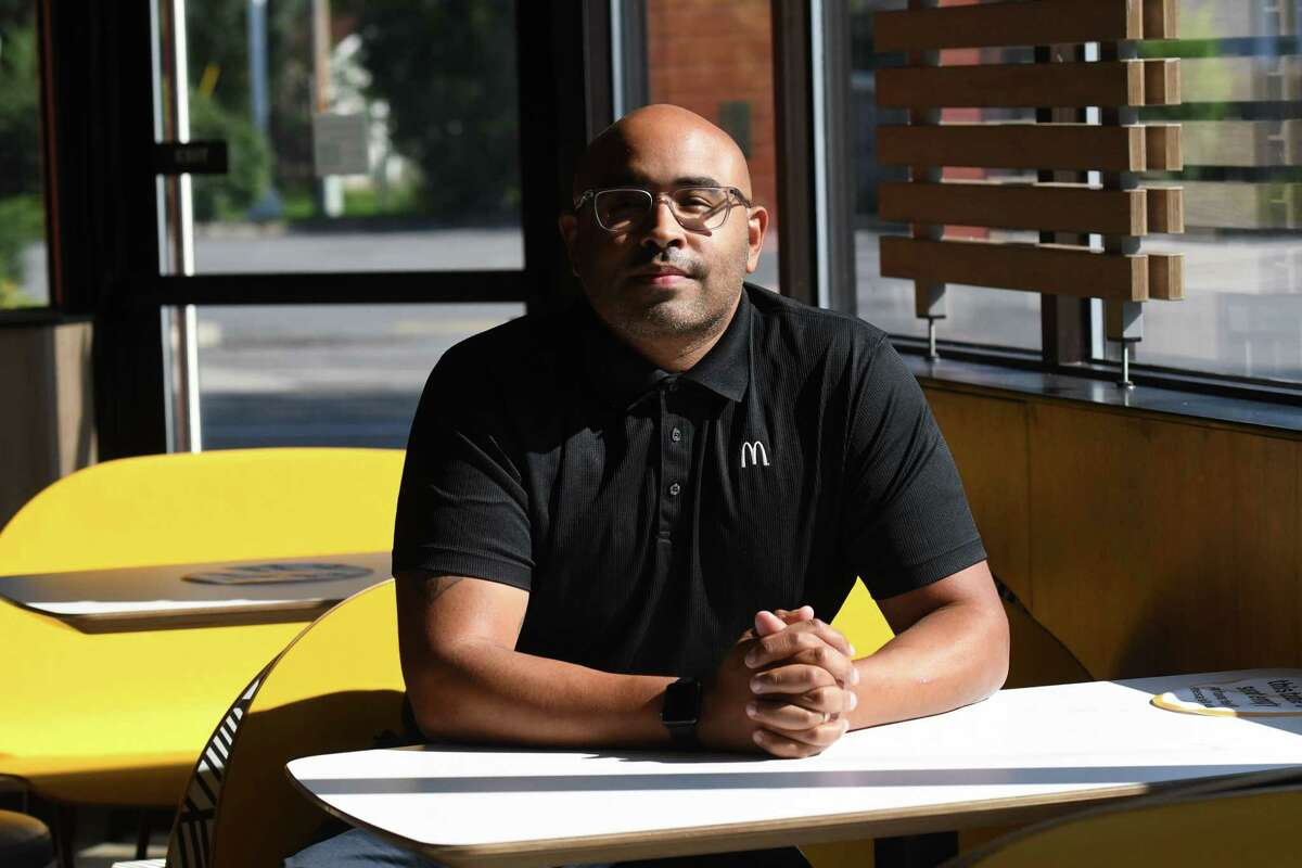 Julio Gillis, who co-owns17 McDonald's locations with his mother, six in the Capital Region, sits in his Curry Road restaurant on Tuesday, Aug. 24, 2021, in Rotterdam, N.Y. As a capstone to August as National Black Business Month, Gillis and his mother will be doing a giveaway of 500 school backpacks this Saturday at their Schenectady location.