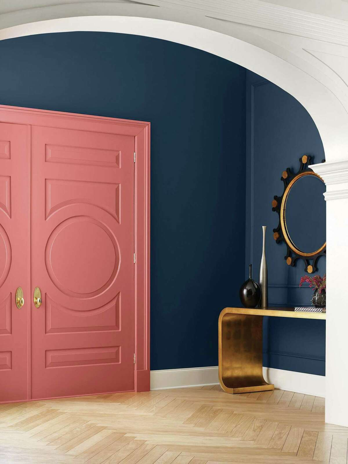 """Sherwin-Williams uses """"Coral Clay"""" on doors and """"Naval"""" on walls from its Opus Palette in its 2022 Colormix Forecast."""