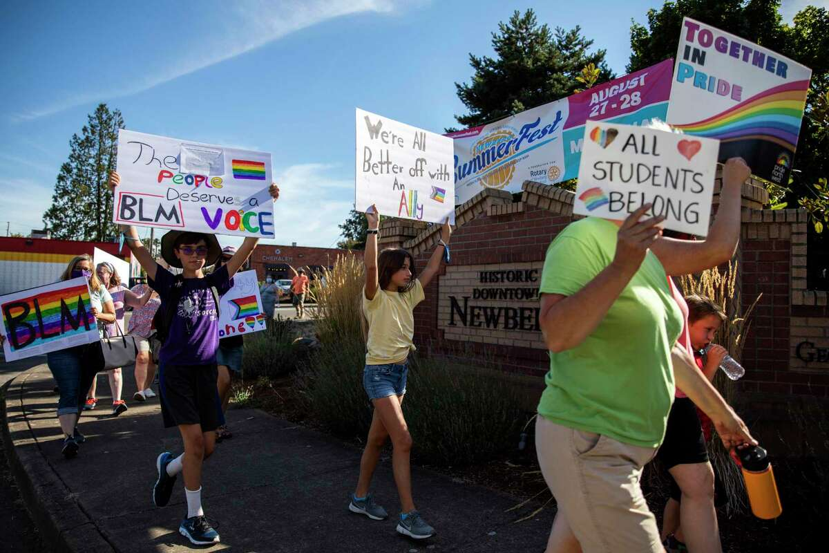 People demonstrate in Oregon in support of LGBTQ and Black students. One way to break through culture wars is to connect with others with the the highest intention of understanding.