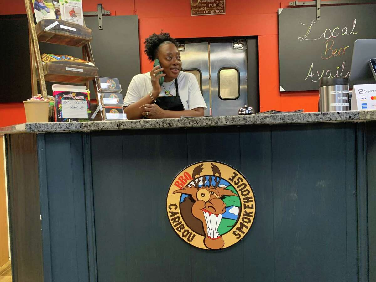 Owner Elaine Wilson is shown at the counter of the newly opened Caribou BBQ Smokehouse on South Main Street in Middletown.
