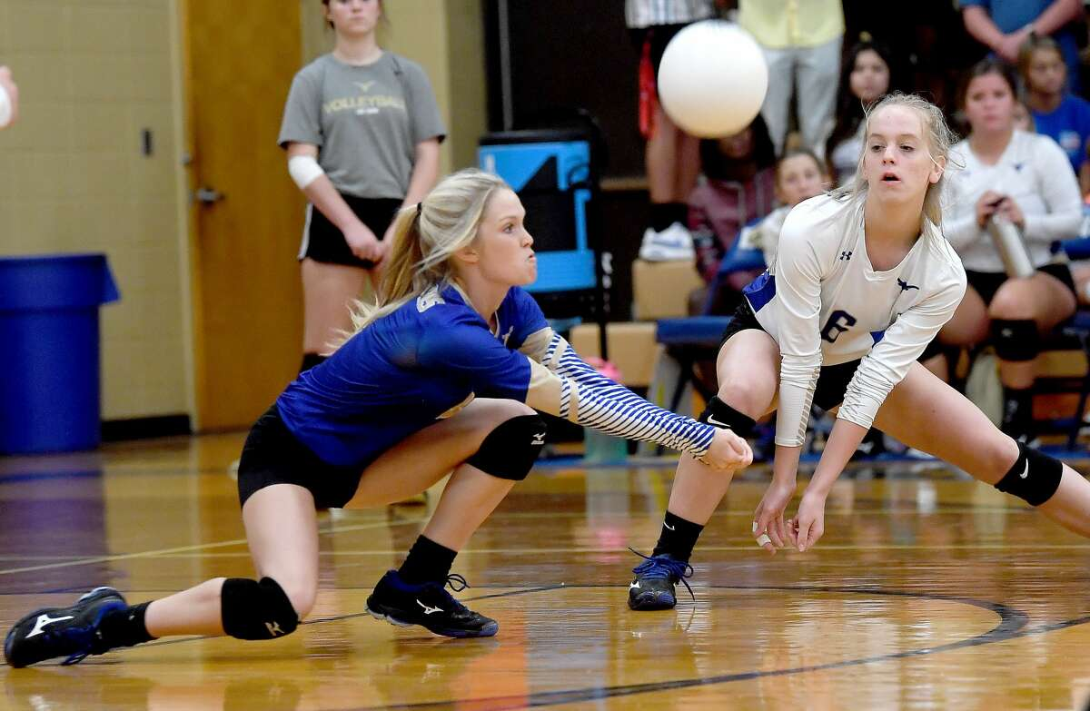 Hamshire-Fannett's Evie Woodall and Charleigh Callahan dive to keep the ball in play against Beaumont United at home Tuesday. Photo made Tuessday, August 24, 2021 Kim Brent/The Enterprise