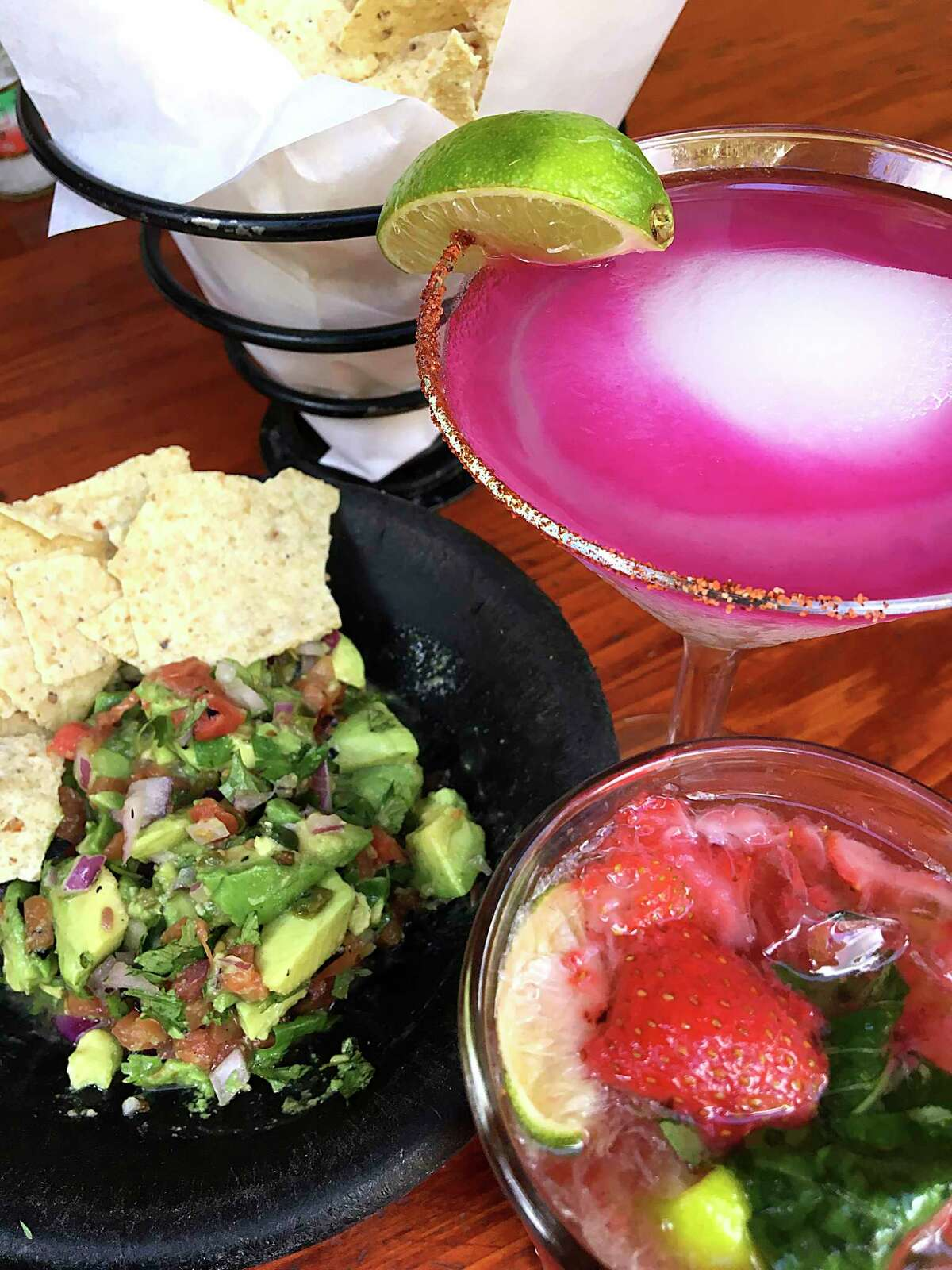 The frozen prickly pear margarita (right) long has been a hit at Boudro's Texas Bistro on the River Walk.