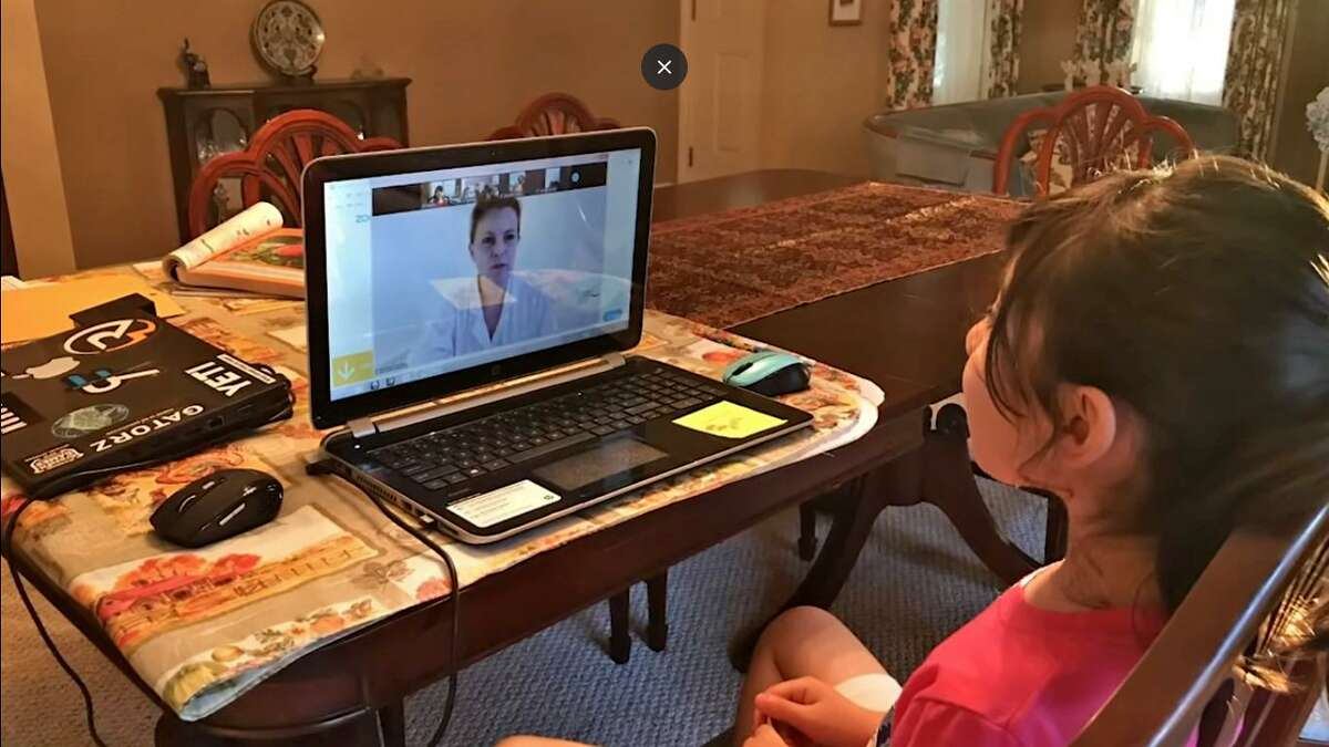 A student engages with a teacher online.